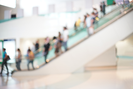 Blurred photo of escalators in modern building, background uses.