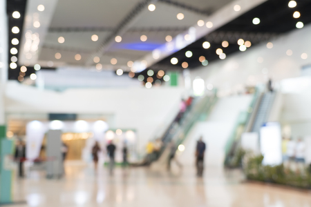 Blurred photo of escalators in modern building, background uses