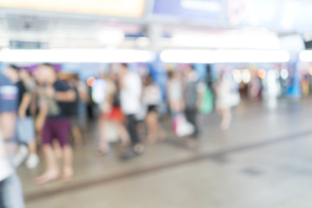Blurred image of people at train station for background useの写真素材