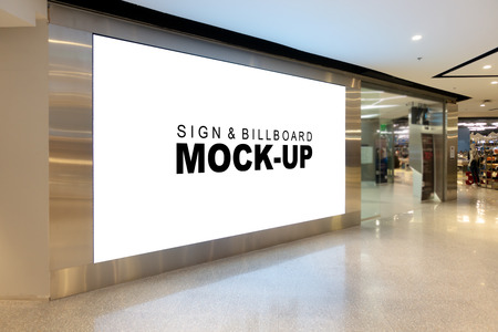 Foto de Mock up large billboard with clipping path at corridor, perspective white screen empty space for advertisement on the wall near walkway in the shopping mall - Imagen libre de derechos