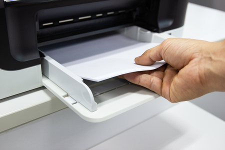 Photo for hand man lay down the paper from printer in the office, Business concept - Royalty Free Image