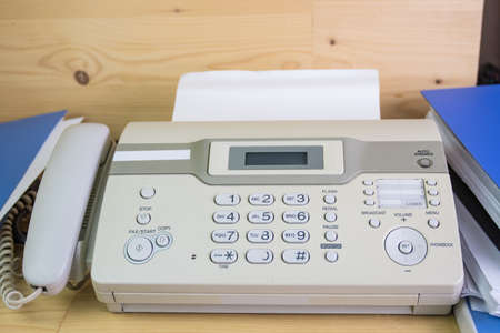 Photo for The fax machine for Sending documents in the office concept equipment needed in office - Royalty Free Image