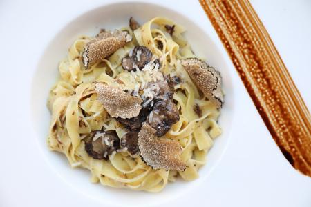Photo pour pasta with black truffles on wood background , Italian food - image libre de droit