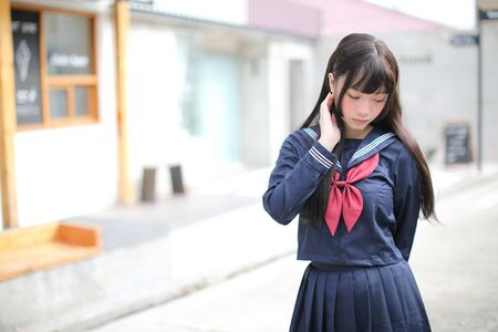 Photo for Portrait japanese school girl in downtown ice cream shop - Royalty Free Image