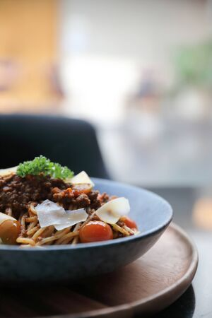 Photo for spaghetti Bolognese with minced beef and tomato sauce garnished with parmesan cheese and basil , Italian food - Royalty Free Image