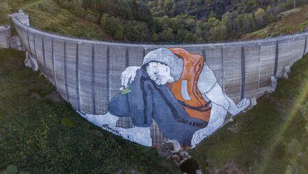 LA VALLA-EN GIER, FRANCE - OCTOBER 05, 2017: Huge mural on the abandoned Piney dam in France