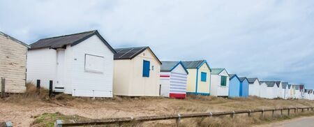 A row of beach huts on a dull winters day by the seaside.
