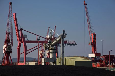 Dockside Machinery and Unloaded Imported Coal at Avonmouth UK
