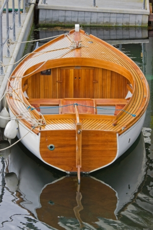 Wooden rowboat in dock