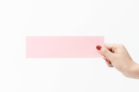 Photo pour Close up women holding pink blank paper on white background. Free space, ready for type with text banner. - image libre de droit