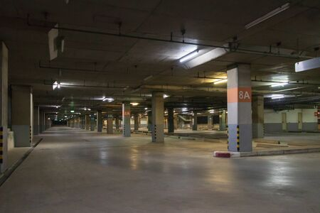 Photo for Empty parking interior at night. Parking garage at eight floor. - Royalty Free Image