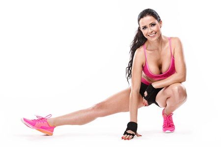 stretching fitness sexy woman isolated on white background