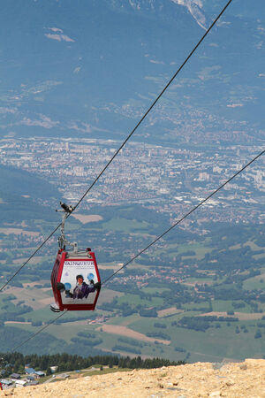 CHAMROUSSE, FRANCE, JULY 17, 2014   Chamrousse cable car ver the city of Grenoble   Chamrousse is a well-known ski resortand the nearest of Grenoble city