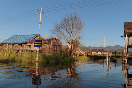 INLE LAKE, MYANMAR, December 15, 2014 : The tribe of Inthar, which populates the region, built on the water its houses on piles and lives on generative culture of fruits, vegetables and flowers on incredible floating islands