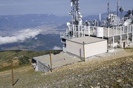 CHAMROUSSE, FRANCE, July 22, 2017 : At the top of Chamrousse mountain resort, the TV and weather station over the city of Grenoble.