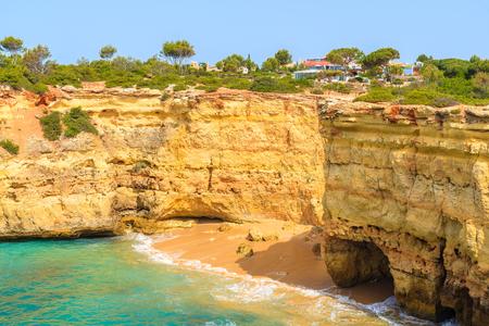 View of beautiful cliffs on sea coast near Carvoeiro town, Algarve, Portugal