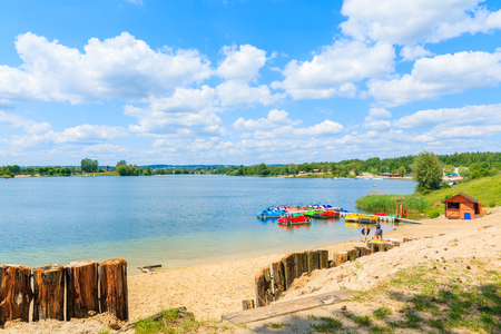 Sandy beach on sunny beautiful summer day, Kryspinow lake near Cracow city, Poland