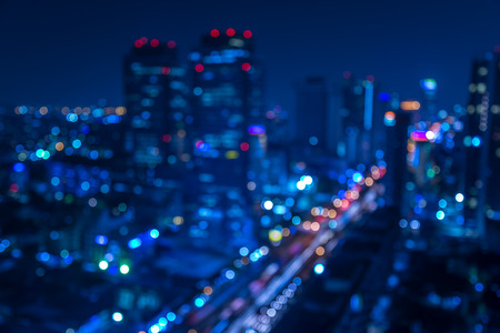 Foto de Defocused urban abstract texture -blurred background with bokeh of city lights from car on street at night - Imagen libre de derechos