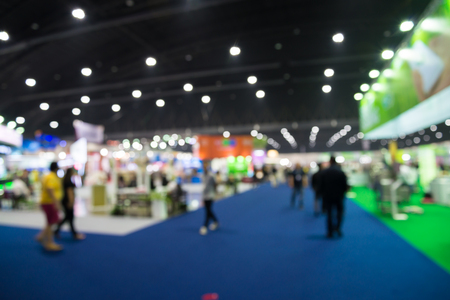 Photo pour Abstract blur people in trade show expo background - image libre de droit