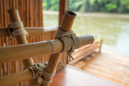 Close up of bamboo furniture rope knot tied - selective focus