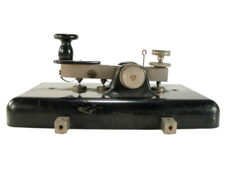 Original old morse key isolated on white.