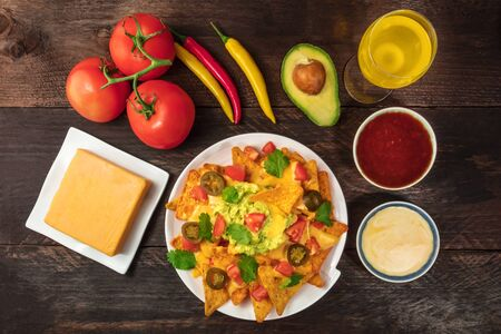 Nachos with cheese, traditional Mexican snack, with ingredients