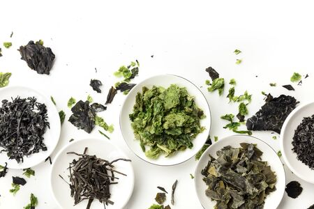 Various dry seaweed, sea vegetables, shot from the top on white. Superfoods background with a place for textの素材 [FY310130023241]