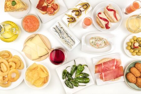 Spanish tapas and wine, an overhead photo of a variety of snacks