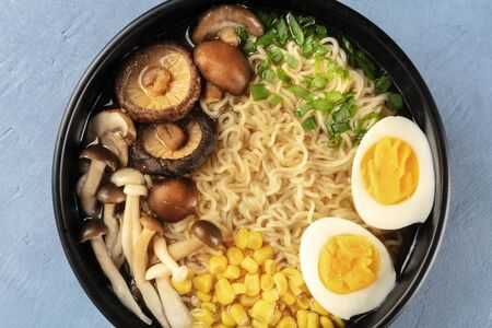 Photo pour Ramen close-up. Soba with eggs, mushrooms, and vegetables, shot from the top - image libre de droit