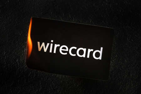 Photo pour Madrid, Spain - June 27, 2020: Wirecard prepaid card burning on fire following the company bankruptcy and the freezing of cardholders money - image libre de droit
