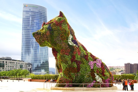 Photo for Puppy in front of the Guggenheim Museum  Bilbao, Spain - Royalty Free Image
