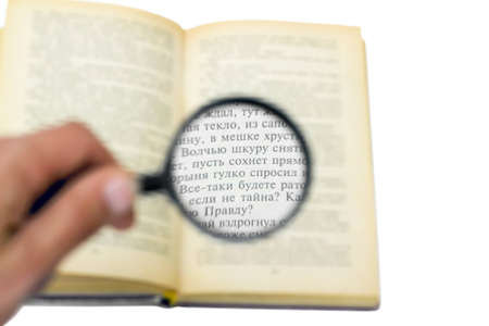 open book under a magnifying glass isolated on white background