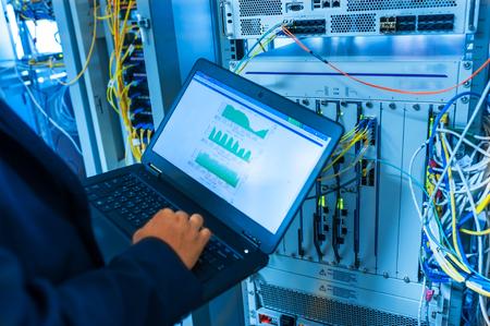 Photo pour Fix network switch in data center room . - image libre de droit