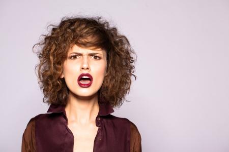 angry beautiful young woman shouting