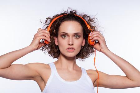 young beautifull woman listening to something strange