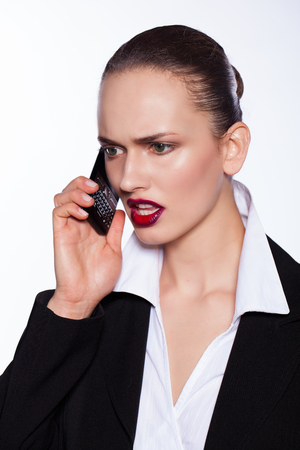 angry beautiful young woman talking at the phone