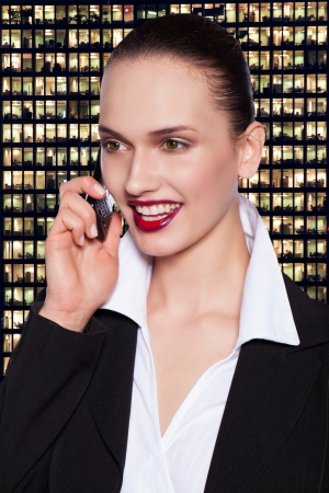 happy beautiful young woman talking at the phone