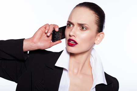 puzzled beautiful young woman talking at the phone