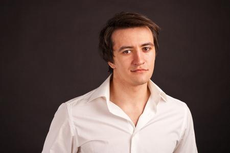 Portrait adult man on black background