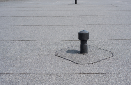 Photo pour Roof ventilation. Aerator - flat roof ventilation. Roofing felt. Roof ventilated. - image libre de droit