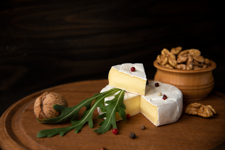Photo for Cheese camembert or brie with walnuts and arugula - Royalty Free Image