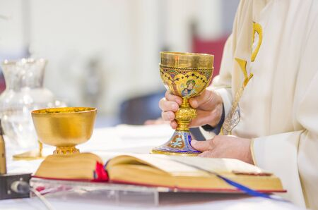 Photo pour in the church wine becomes the blood of christ, and the host becomes the body of christ - image libre de droit