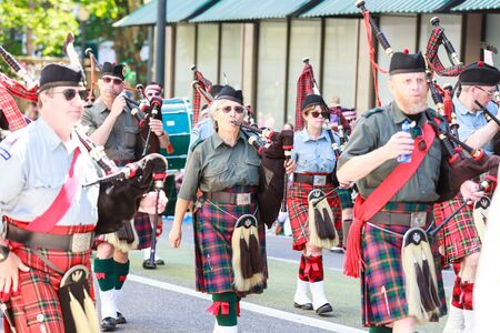 Portland, Oregon, USA - JUNE 7, 2014  Clan Macleay Pipe Band in Grand floral parade through Portland downtown
