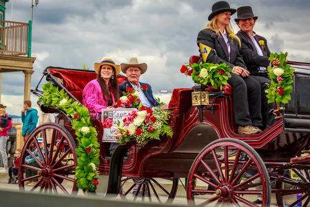 Portland, Oregon, USA - June 8, 2019: Grand Marsha, Vern Hulit and his daughter Stacey Flintjer,l in the Grand Floral Parade, during Portland Rose Festival 2019.