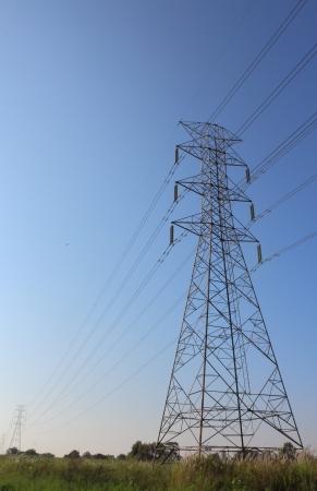Photo pour Electric high voltage power post in the field - image libre de droit