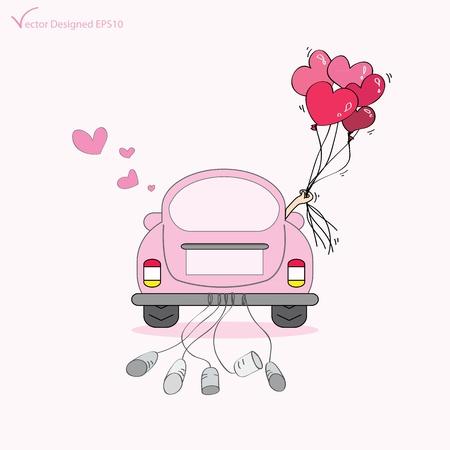 Foto de Just married on car driving to their honeymoon  - Imagen libre de derechos