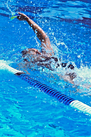 Photo pour Swimmer full effort  in the sports competition pool - image libre de droit
