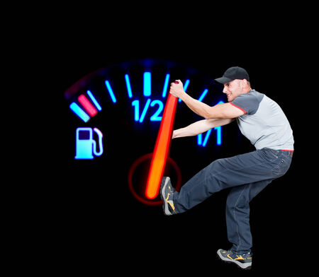 Angry man pulling the fuel needle, global warming conceptual, image not resized, gauge in macro mode,