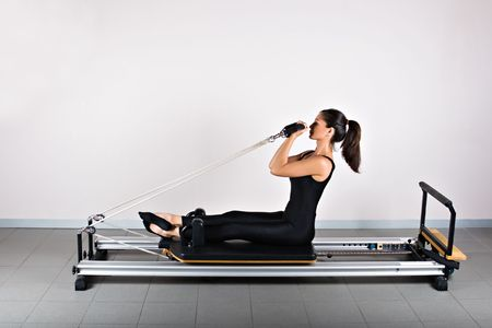 Bicep reformer position. Pilates gymnastics is a Germanic evolution of yoga, used by athletes to improve flexibility and body fitness and by chiropractors for patient recovery.