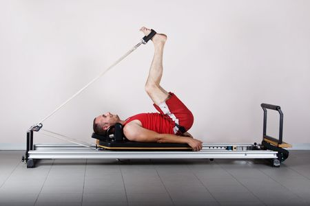 The L position with cords. Pilates gymnastics is a Germanic evolution of yoga, used by athletes to improve flexibility and body fitness and by chiropractors for patient recovery.